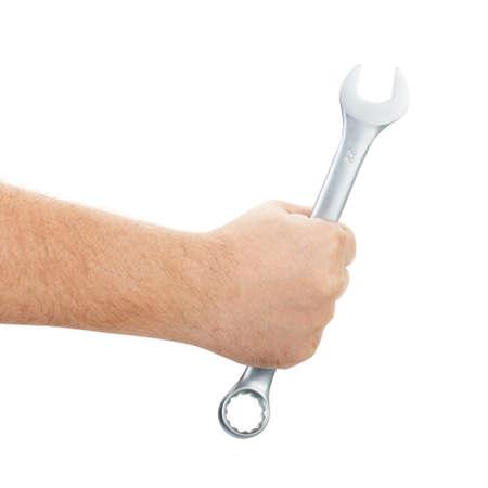 Mechaniker Hand hält Schraubenschlüssel in der Hand auf weiß