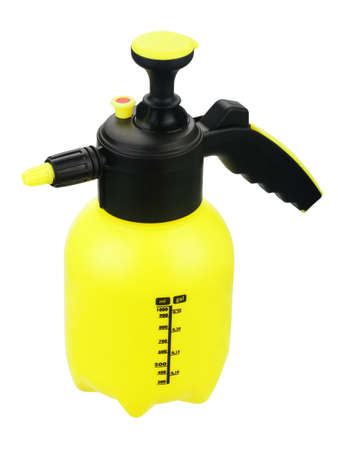 Yellow sprayer with pump on white background Stok Fotoğraf