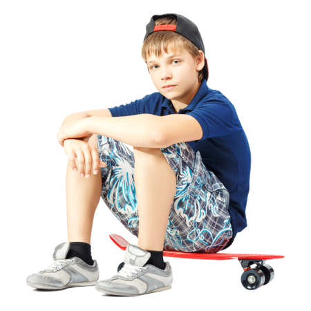 Tired teenager sitting on a skateboard isolated on white background
