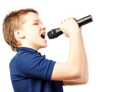 Teenage boy singing into a microphone on a white background. Very emotional.