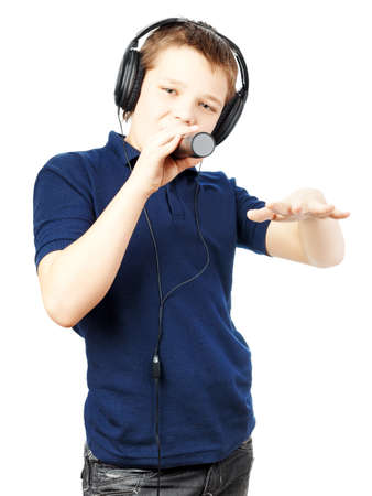 Teenage boy singing into a microphone and gesticulates with a hand on a white background. Very emotional. Reklamní fotografie