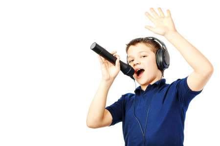 Teenage boy singing into a microphone and gesticulates with a hand on a white background. Very emotional.