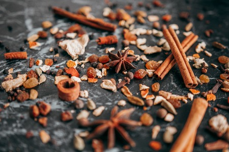 Collection of spices for mulled wine and pastry on the wooden table 写真素材
