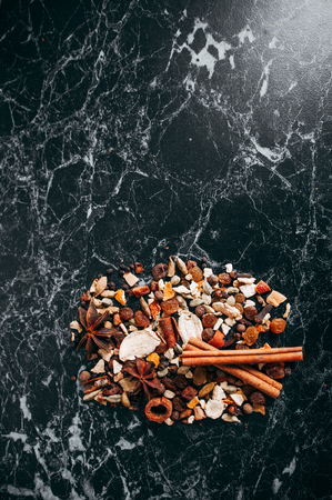 Collection of spices for mulled wine and pastry on the wooden table Stock Photo