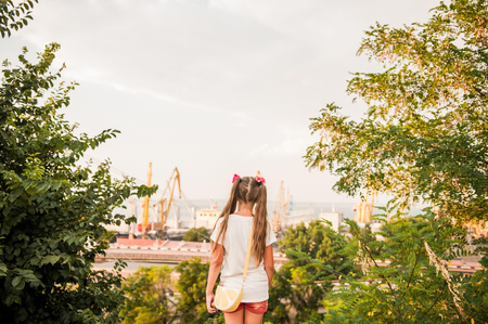 A little girl looks at the port of Odessa.