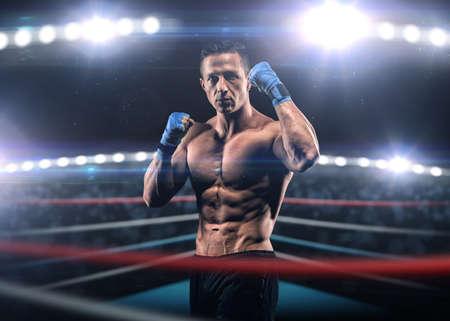 cerillas: Un hombre fuerte en el ring en vendas de boxeo azules preparándose para la batalla Foto de archivo