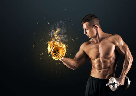 fit people: Handsome power athletic man bodybuilder doing exercises with dumbbell. Fitness muscular body on dark background.