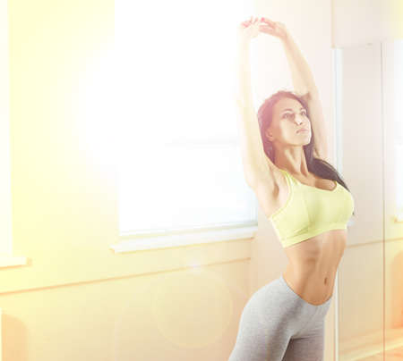 muscle gain: sporty woman in gym