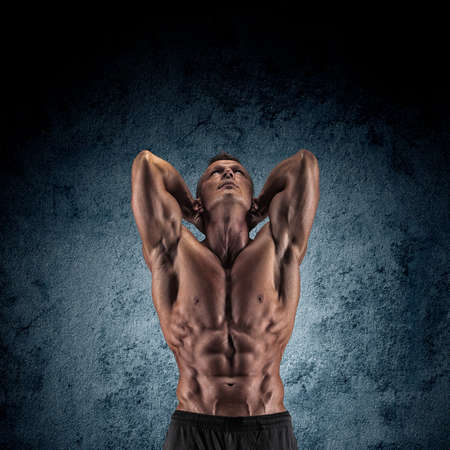musculation: Sexy muscular guy in the studio shows the various movements Stock Photo