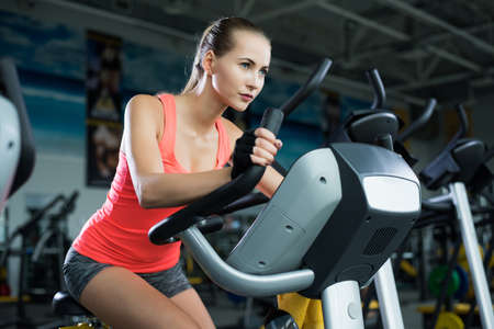 girl action: Athletic young woman resting during exercise in the gym