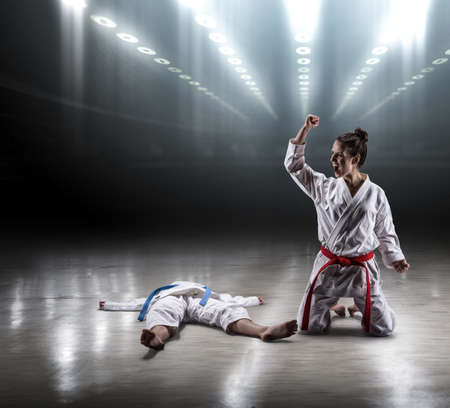 opponent: Sexy girl in a kimono karate enjoys heavy victory over a strong opponent