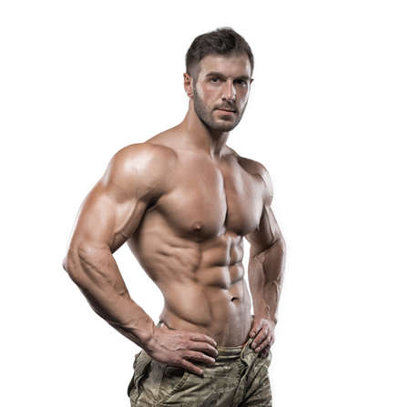 Young handsome muscular man bodybuilder posing in the studio on a white background