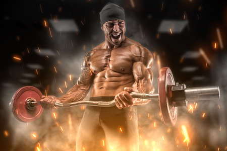 Big angry athlete trains in the gym
