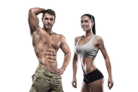 Sports guy and sexy girl posing in the studio