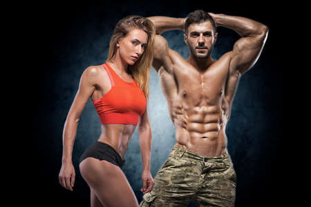 Man and woman on a dark background. Fitness couple. Stock Photo