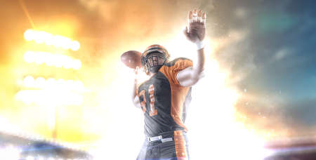 American football player at the stadium in black and orange outfit. 版權商用圖片