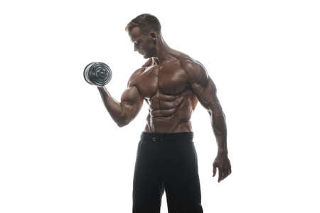 Fitness model Man posing in the studio. White background. Isolated. Stock Photo