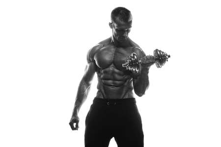 Fitness model Man posing in the studio. White background. Isolated.