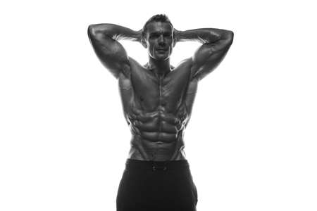Fitness model Man posing in the studio. White background. Isolated. Фото со стока - 131454585