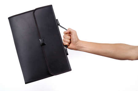 human hand holding briefcase isolated Stock Photo - 9286962