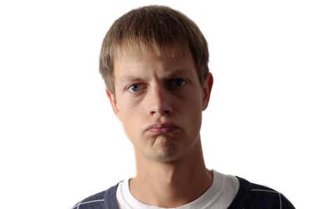 displeased: displeased young man isolated Stock Photo