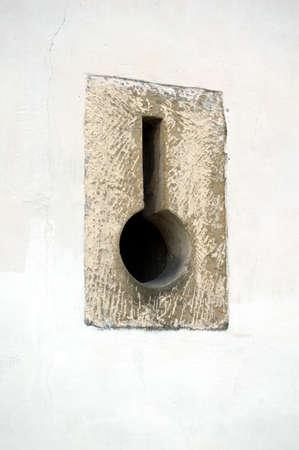 loophole: loop-hole in wall Stock Photo