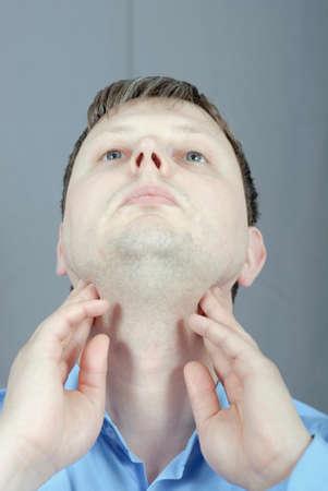 man explores the lymph nodes  photo