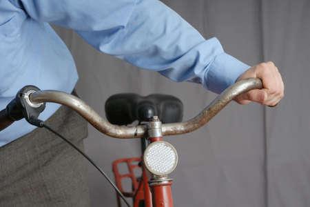 handlebar: human hand holding bicycle handlebar Stock Photo