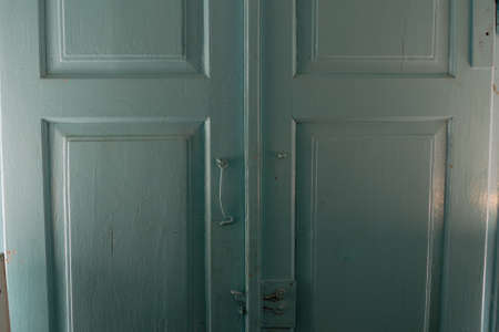 sidelight: Old beautiful wooden blue door inside of house in the good sidelight. Door has bolt and detent.