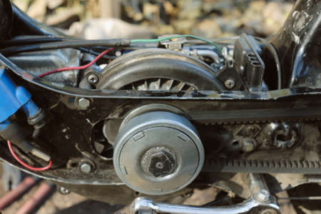 carburettor: Photo of moped engine without casing. Why without ? Because engine has breakage and scooter owner repair it now. Stock Photo