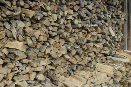 stack of firewood: DSLR photo of dry, sliced stack of firewood.