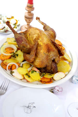 roasted chicken on a bed of vegetables photo