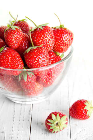 lots of delicious strawberries on a plate Stock Photo