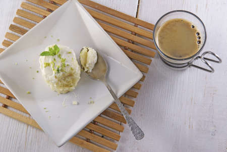 sized: Dessert one bite-sized with cheese cream and gagzest. On a wooden rustic table, with fresh fragrant coffee Stock Photo