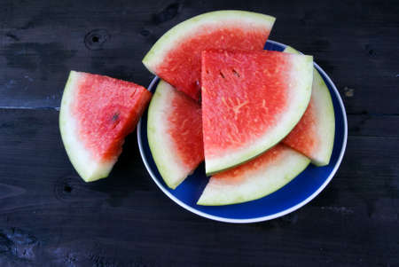 sliced watermelon: Sliced ??watermelon on a wooden table
