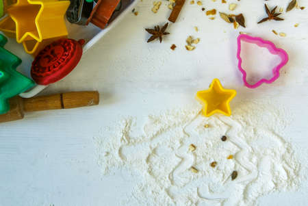 Preparations for Christmas and New Year. Baking Christmas cookies. On a white wooden table, top view