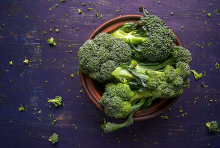 brocoli: Fresh raw broccoli on a wooden table, top view, copy space Stock Photo