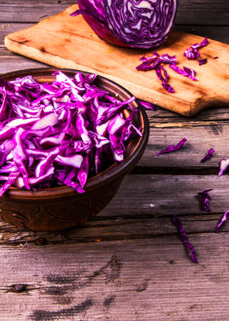 the residue: Sliced ??purple cabbage in a bowl, and the residue of it on a cutting board. Vitamin autumn meal. Copy space