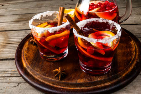 Fragrant autumn and winter sangria with oranges, apples, cranberries and spices