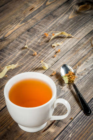 The concept of home spring relaxation: herbal homemade linden tea, vertical, copy space