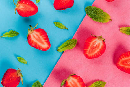 Fresh raw organic seasonal fruits and berries. The seamless pattern - mint, strawberry on a colorful blue and pink background. Top view copy space