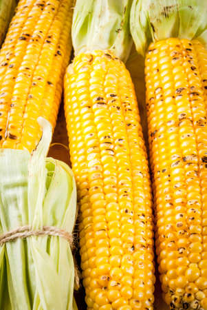 Autumn bbq, Grilled corn on white marble table, top view copy space
