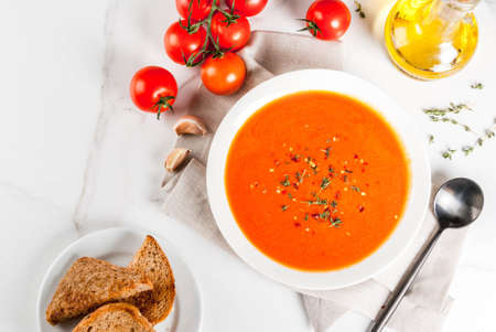 Tomato cream soup with olive oil and herbs, with toasted bread, on white marble background, copy space top view Stock fotó - 86531256