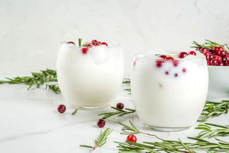 ideas for drinks for xmas and thanksgiving white christmas margarita punch with cranberries and rosemary - Christmas Punch Ideas