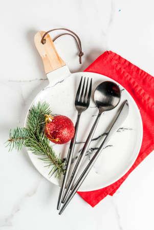 Christmas table setting with christmas tree branch and christmas ball, top view copy space