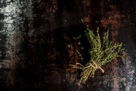 Bunch of fresh organic thyme on an old metallic rusty black background, copy space top view Banco de Imagens - 88930739