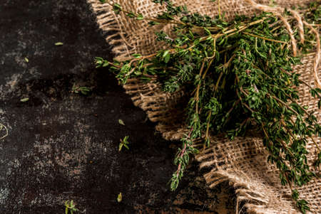Bunch of fresh organic thyme on an old metallic rusty black background, copy space Stok Fotoğraf