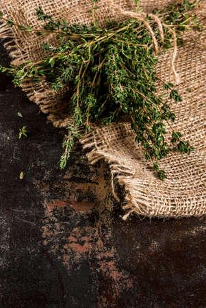 Bunch of fresh organic thyme on an old metallic rusty black background, copy space Banco de Imagens