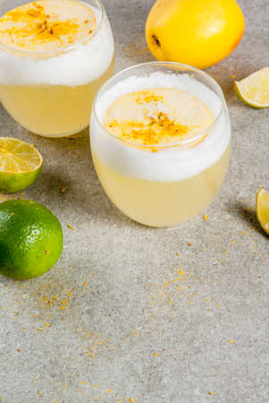 Peruvian, Mexican, Chilean drink recipes, Pisco Sour and  Apple Cider cocktail, on gray stone table, copy space