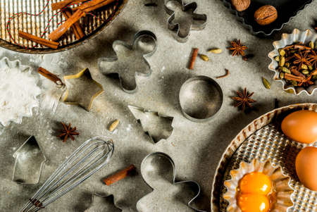 Baking equipment and ingredients, cooking christmas pastries and cookies background, vintage, top view, gray stone table, copy space Lizenzfreie Bilder